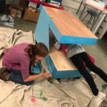 students painting cart