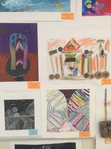4 photos of student artwork, a cake, an abstract pattern drawing, a scratchboard and collage.