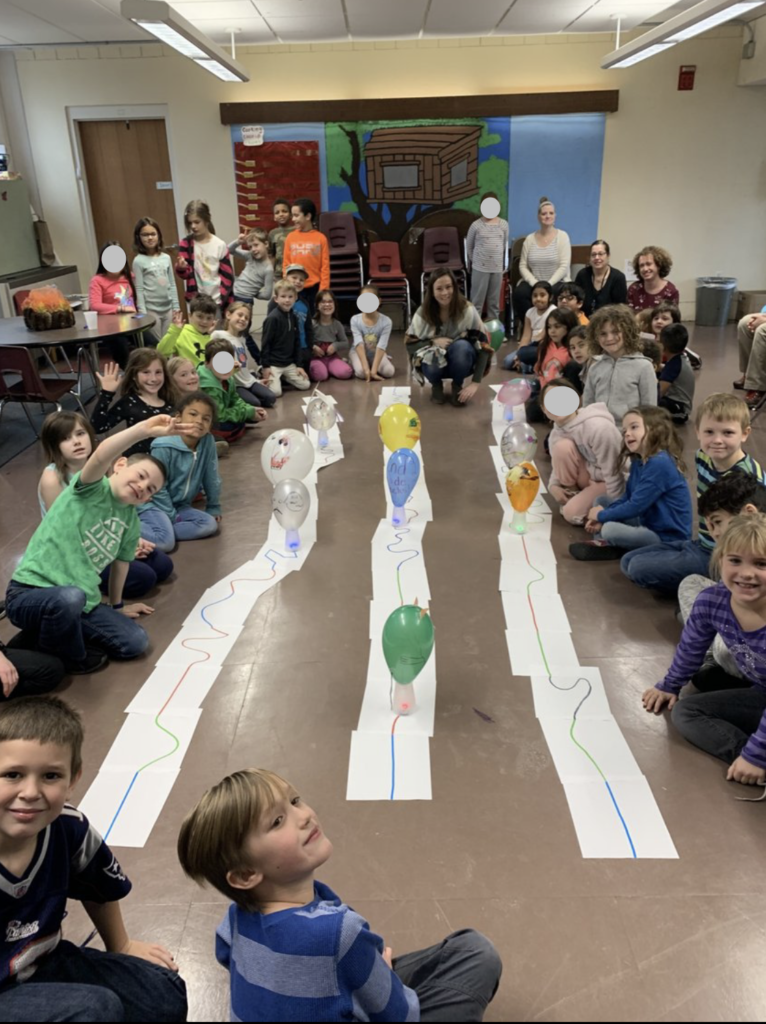 Full 2nd grade circled around the parade track and decorated robots.